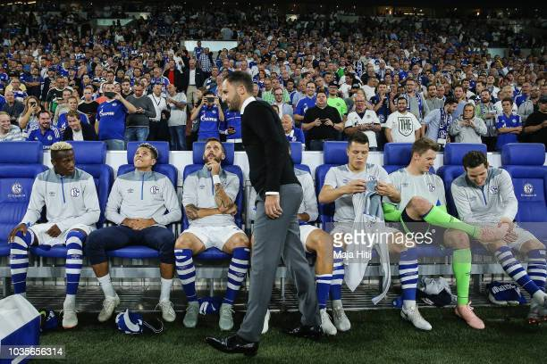 Domenico Tedesco, Manager of FC Schalke 04 shakes hands with his team on the bench ahead of the Group D match of the UEFA Champions League between FC...