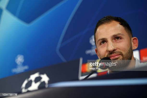 Domenico Tedesco, Manager of FC Schalke 04 speaks to the media during the Schalke 04 press conference at Veltins-Arena on September 17, 2018 in...