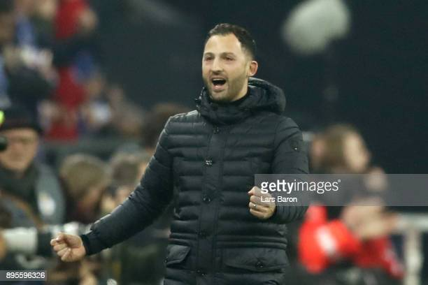 Domenico Todesco head coach of Schalke celebrates his team first goal prior to the DFB Cup match between FC Schalke 04 and 1FC Koeln at VeltinsArena...