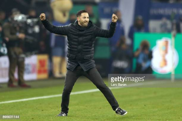 Domenico Todesco head coach of Schalke celebrates victory after winning the DFB Cup match between FC Schalke 04 and 1FC Koeln at VeltinsArena on...