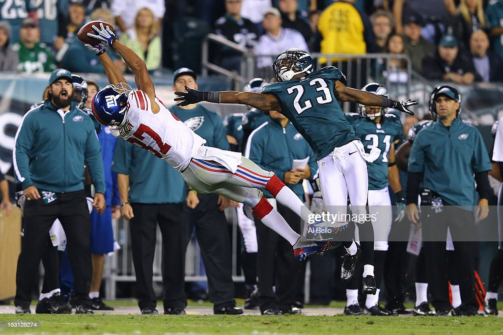 Domenik Hixon #87 of the New York Giants catches a pass against Dominique Rodgers-Cromartie #23 of the Philadelphia Eagles during their game at Lincoln Financial Field on September 30, 2012 in Philadelphia, Pennsylvania.