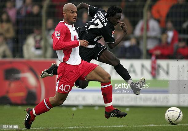 Domenique Ndjeng of Ahlen in action with Jonathan Pitroipa of Freiburg during the Second Bundesliga match between LR Ahlen and SC Freiburg at the...