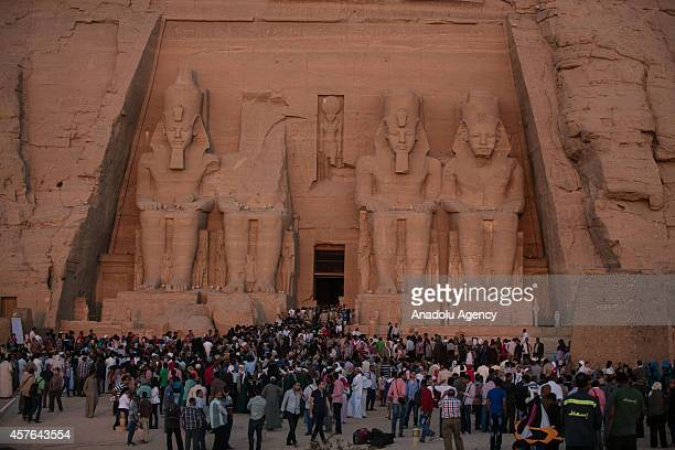 Domestic and foreign tourists come to the Abu Simbel temples to see the sunbeams lighting up the statues of King Ramesses II and other 'gods' twice a...