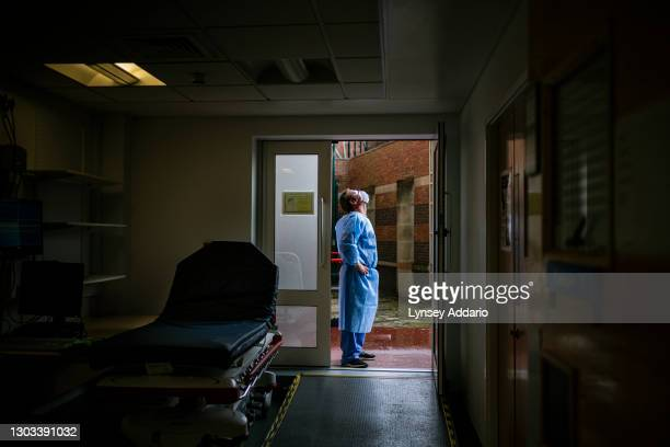 Domestic caretaker Jim Johnson takes a breath of fresh air and feels the rain on his face outside the paramedic's entrance of the triage area in the...