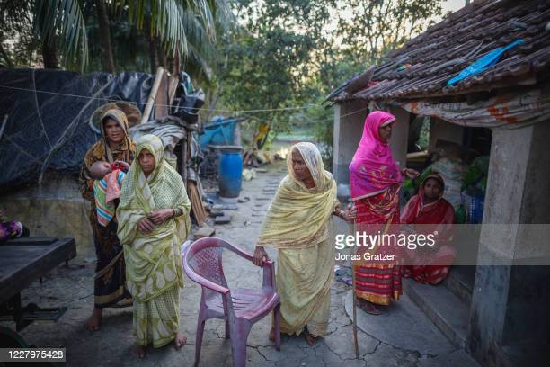 Domestic climate refugees in their new house at ghoramara island in Sunderbans. With the ocean swallowing up land in the worlds largest mangrove...