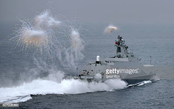 A domestic constructed guided missile corvette ship launches flares during a drill at sea near the naval port in Kaohsiung in southern Taiwan on...