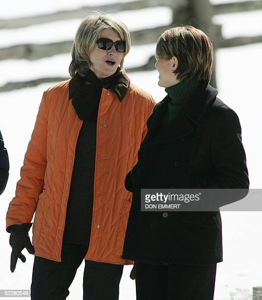 Domestic diva Martha Stewart talks to her daughter Alexis as they walk on her property 05 March 2005 in Bedford New York Stewart left prison 04 March...