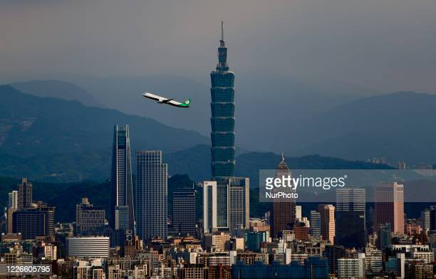 Domestic flight connecting Taipei City to Nangan Township departs from Songshan Airport and passes through in front of the Taipei 101 building, amid...