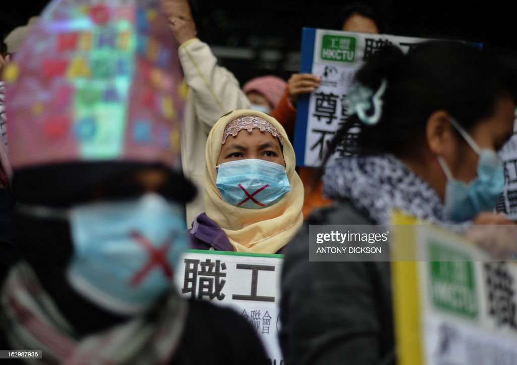 Domestic helpers gather to ask the government in Hong Kong to protect them from violence, on March 3, 2013. One week from International Women's Day, the workers rights group asked the Hong Kong government to provide greater assistance to victims of sexual and other abuse with in the workplace. AFP PHOTO / Antony DICKSON