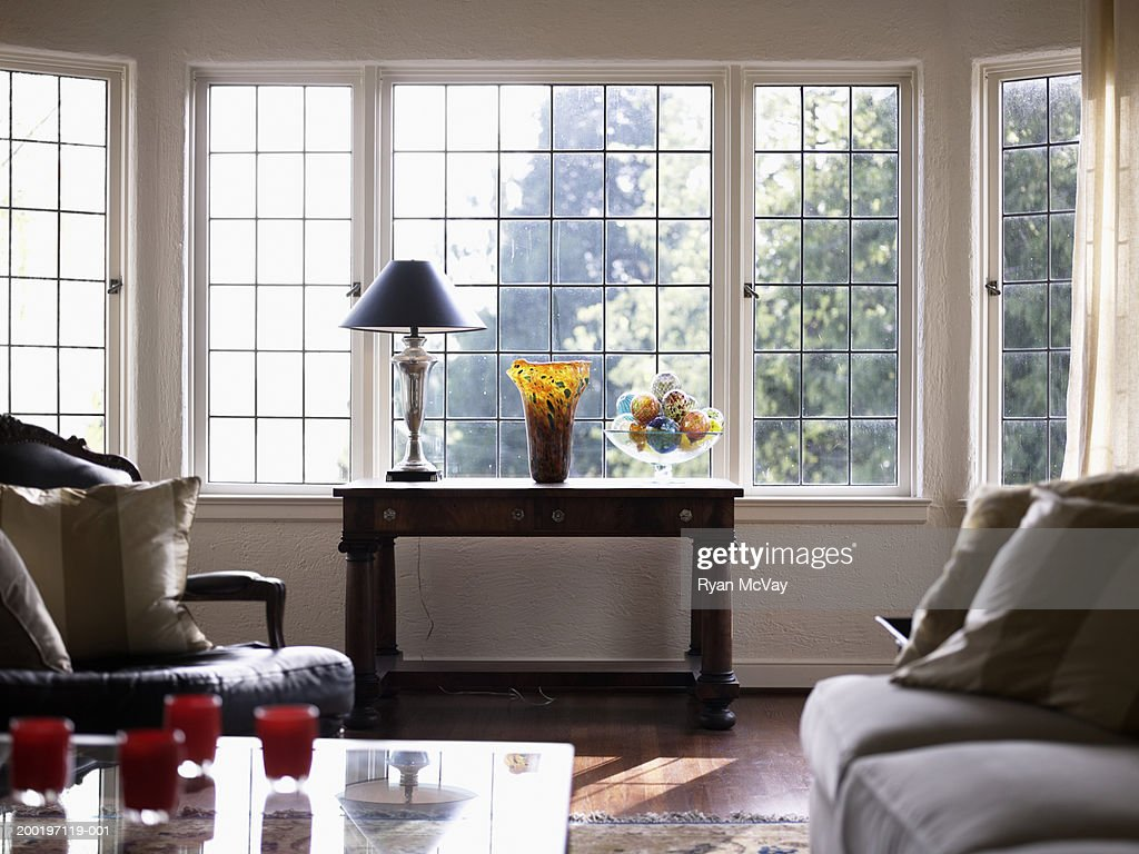 Domestic living room (focus on side table beside window) : Stock Photo