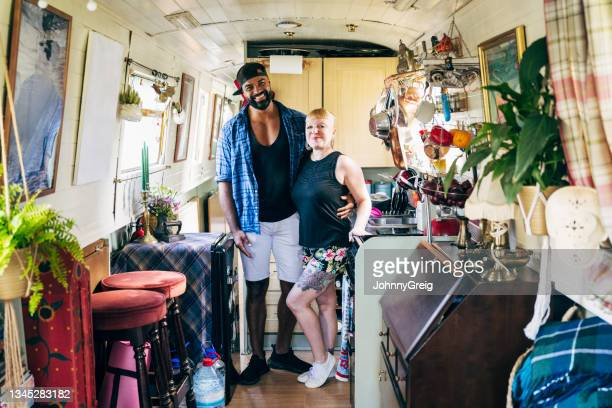 domestic portrait of british couple in narrowboat kitchen - ambient light stock pictures, royalty-free photos & images