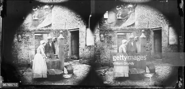 A domestic servant washing fish at the pump circa 1857 From William Grundy's 'English Views'