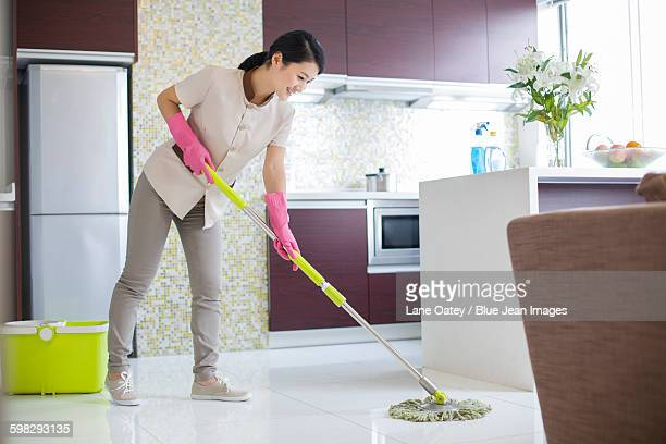 Domestic staff cleaning kitchen