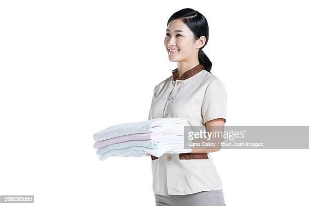 Domestic staff doing laundry