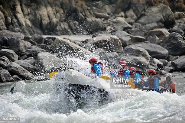 Domestic tourists enjoy white water rafting through the rapids at Trishuli River 85Km from the capital Kathmandu