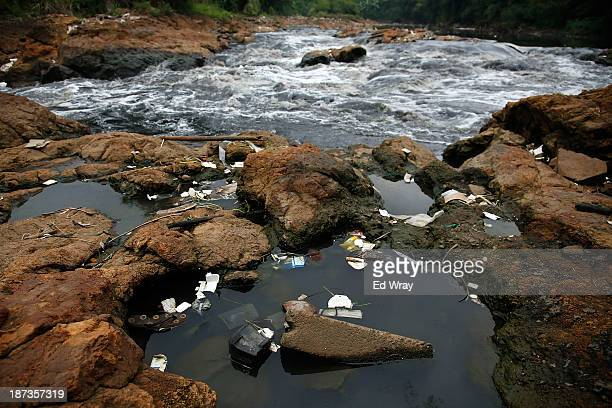 Domestic waste collects in pools next to a waterfall on the Citarum river on November 8 2013 in Cipatek Indonesia The effects of domestic and...