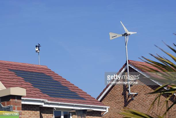 Domestic wind turbine and solar electric and thermal panels Ecosmart housing project Buckshaw View built in conjunction with Manchester University...