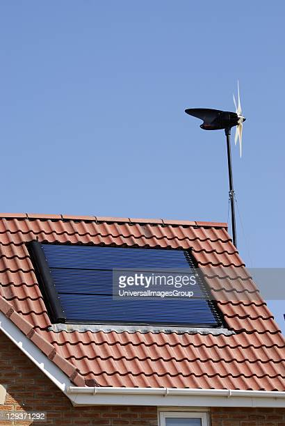 Domestic wind turbine and solar panels on roof Ecosmart housing project Buckshaw View built in conjunction with Manchester University and Barratts...