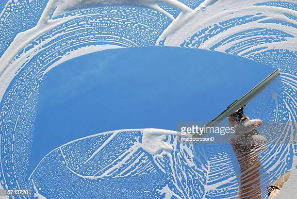 domestic window cleaner washing - window cleaning stock photos and pictures