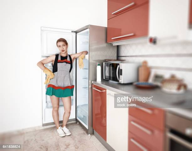 domestic work inside the kitchen - green glove stock photos and pictures