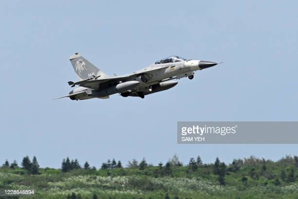 Domestically-produced F-CK-1 indigenous defence fighter jet takes off during a visit by the island's president and the media from Penghu Air Force...
