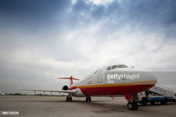 A domesticmade ARJ21 'Xiangfeng' sits on the tarmac at Yangzhou Taizhou International Airport before its monthlong test flight on June 27 2018 in...