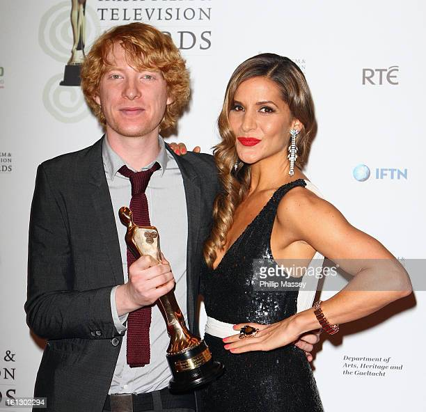 Domhnall Gleeson and Amanda Byram pose in the Press Room after receiving the Best supporting actor in film award for his role in 'Anna Karenina' at...