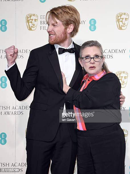 Domhnall Gleeson and Carrie Fisher pose in the winners room at the EE British Academy Film Awards at the Royal Opera House on February 14, 2016 in...
