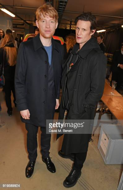 Domhnall Gleeson and Matt Smith wearing Burberry at the Burberry February 2018 show during London Fashion Week at Dimco Buildings on February 17 2018...