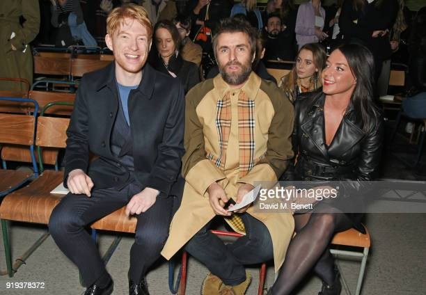 Domhnall Gleeson Liam Gallagher and Debbie Gwyther wearing Burberry at the Burberry February 2018 show during London Fashion Week at Dimco Buildings...