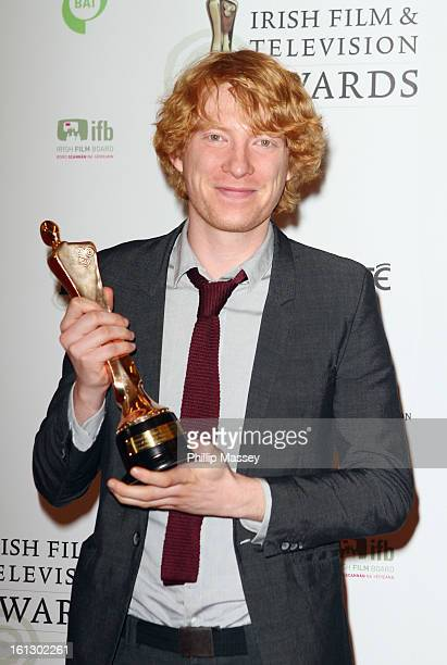 Domhnall Gleeson poses in the Press Room after receiving the Best supporting actor in film award for his role in 'Anna Karenina' at the Irish Film...