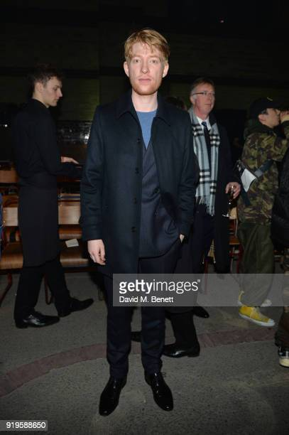 Domhnall Gleeson wearing Burberry at the Burberry February 2018 show during London Fashion Week at Dimco Buildings on February 17 2018 in London...
