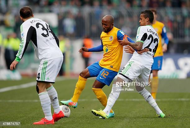 Domi Kumbela of Braunschweig and Luiz Gustavo of Wolfsburg compete forthe ball during the Bundesliga match between Eintracht Braunschweig and VfL...