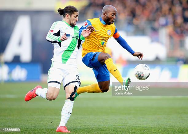 Domi Kumbela of Braunschweig and Ricardo Rodriguez of Wolfsburg compete forthe ball during the Bundesliga match between Eintracht Braunschweig and...
