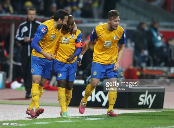 Domi Kumbela of Braunschweig celebrates his second goal with team mates during the Bundesliga match between Eintracht Braunschweig and 1 FSV Mainz 05...