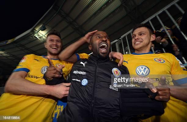 Domi Kumbela of Braunschweig celebrates with Ermin Bicakcic and Mirko Boland at the end of the second Bundesliga match between Eintracht Braunschweig...