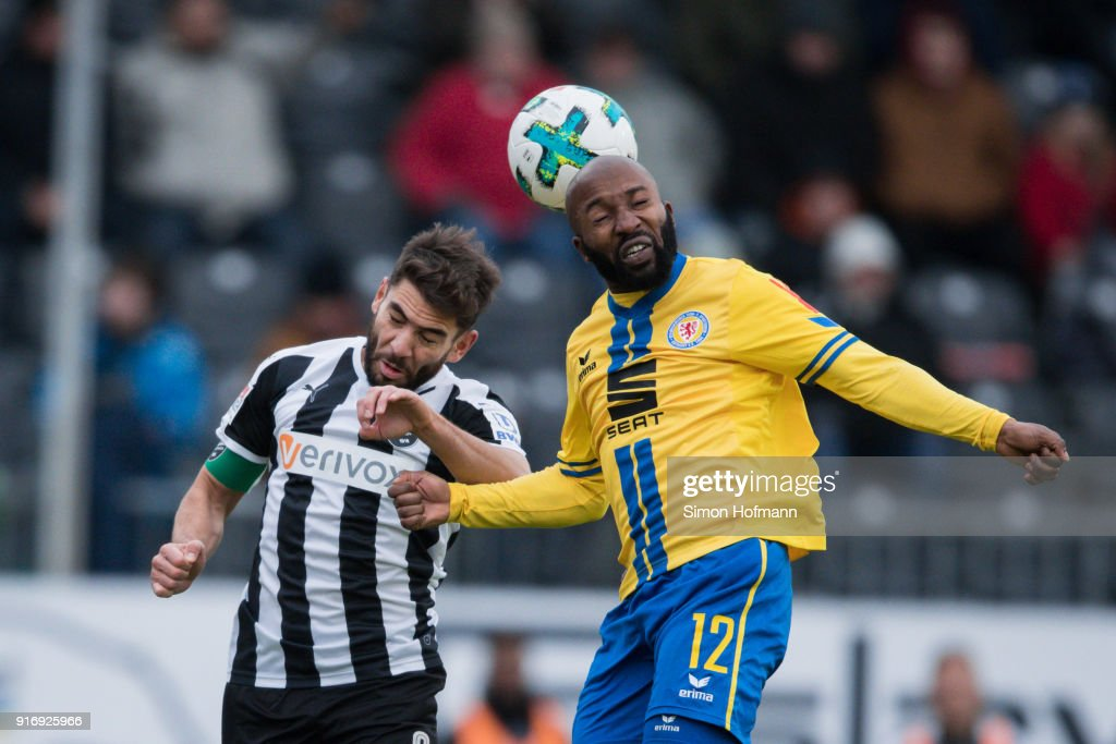 Domi Kumbela of Braunschweig jumps for a header with Nejmeddin Daghfous of Sandhausen during the Second Bundesliga match between SV Sandhausen and Eintracht Braunschweig at BWT-Stadion am Hardtwald on February 11, 2018 in Sandhausen, Germany.