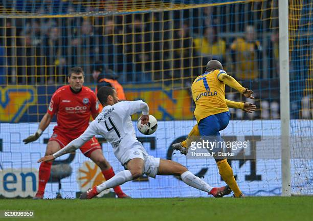 Domi Kumbela of Braunschweig scores his second goal against Wolfgang Hesl and Malcolm Cacutalua of Bielefeld during the Second Bundesliga match...