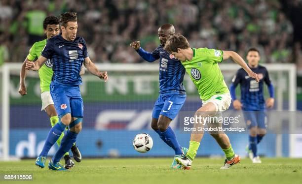 Domi Kumbela of Eintracht Brauschweig is challenged by Philipp Wollscheid of VfL Wolfsburg during the Bundesliga Playoff Leg 1 match between VfL...