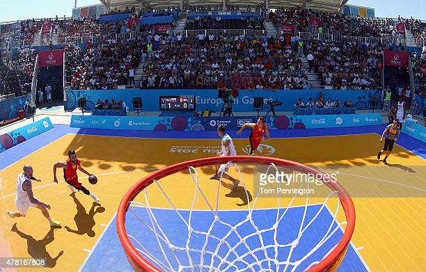 Domien Loubry of Belgium drives to the basket against Ilia Aleksandrov of Russia during the Men's 3x3 Basketball Pool B match on day eleven of the...