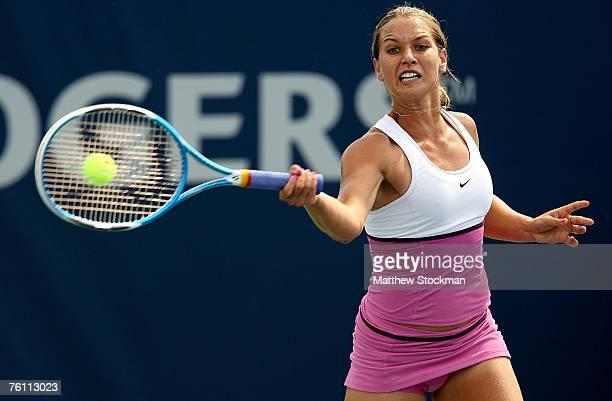Domiinika Cibulkova of Slovakia returns a shot to Tatiana Golovin of France during the Rogers Cup August 15, 2007 at the Rexall Center in Toronto,...