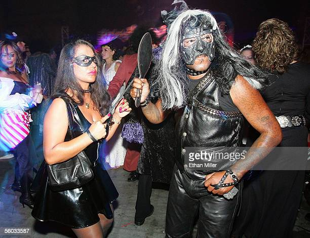 Dominatrix Mistress Contessa and her husband Ken Carey of Nevada dance at the 10th annual Fetish Fantasy Halloween Ball at the Las Vegas Sports...