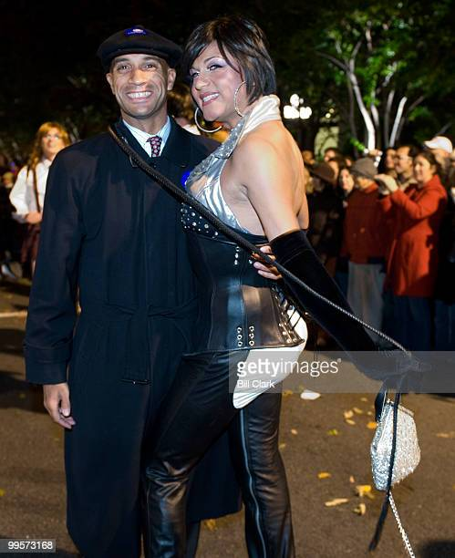 Dominatrix Sierra wraps a bull whip around DC Mayor Adrian Fenty as they pose for photos during the annual High Heel Drag Race on 17th Street NW near...