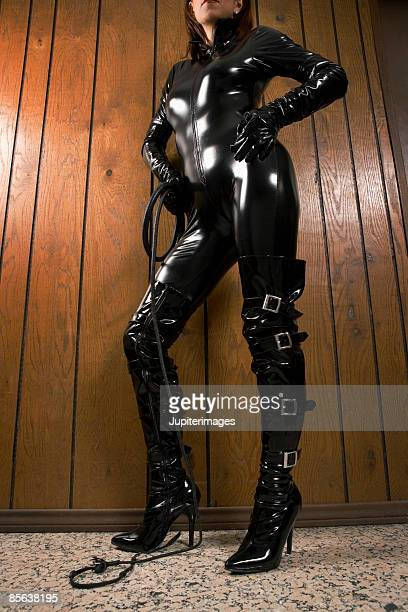 dominatrix standing in office - s and m stock photos and pictures