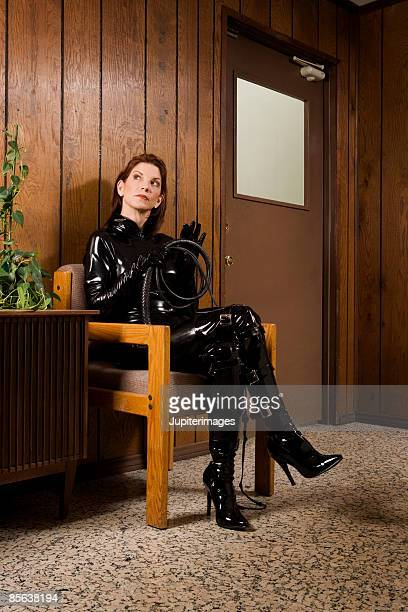 dominatrix waiting in lobby - dominant woman stock photos and pictures