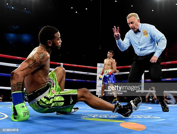 Dominc Wade is given a count by referee Jack Reiss as Gennady Golovkin of Kazakhstan waits during the first round of a unified middleweight title...