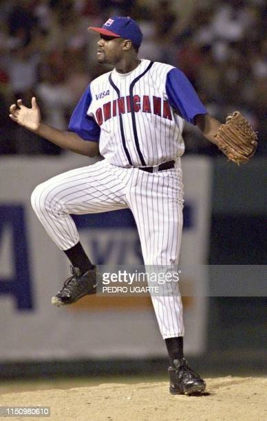 Domincan Republic pitcher Antonio Alfonseca celebrates after the last out against Venezuela in the ninth inning 06 February 2000 in Santo Domingo El...