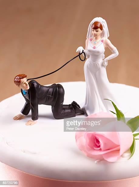 Domineering Bride with Groom on leash.