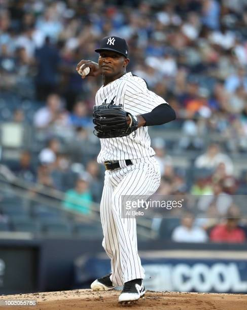 Domingo German of the New York Yankees attempts a pickoff against the New York Mets during their game at Yankee Stadium on July 20 2018 in New York...
