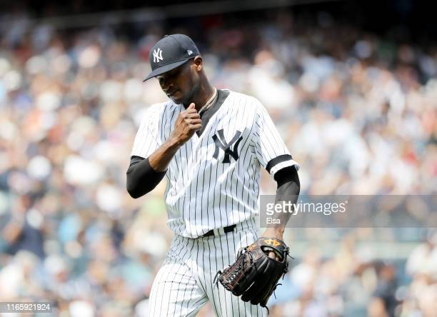 Domingo German of the New York Yankees celebrates as he walks off the field in the fourth inning against the Boston Red Sox during game one of a...